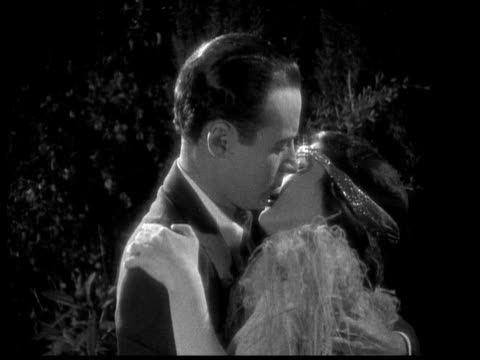 1925 cu b/w couple kissing in garden at night - falling in love stock videos and b-roll footage