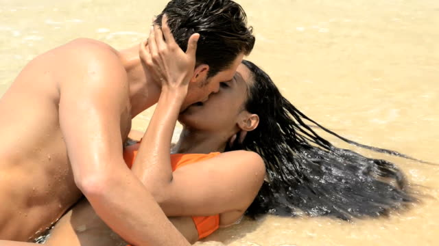 couple kissing in the sea - swimwear stock videos & royalty-free footage