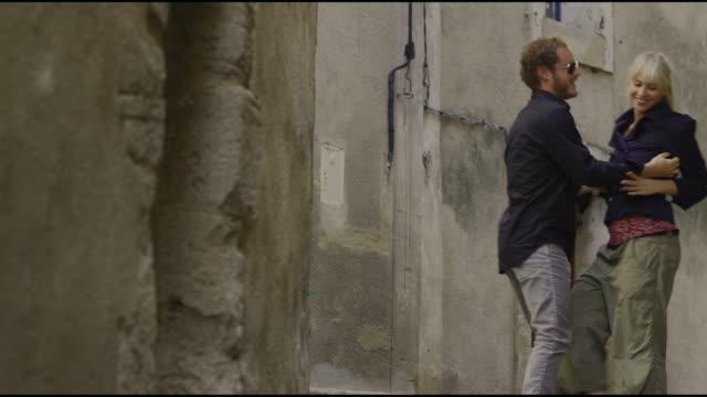 couple kissing on a european street - saignon stock videos & royalty-free footage