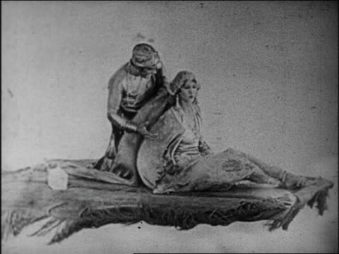 b/w 1924 couple kissing on magic flying carpet / feature - 1924 stock videos & royalty-free footage