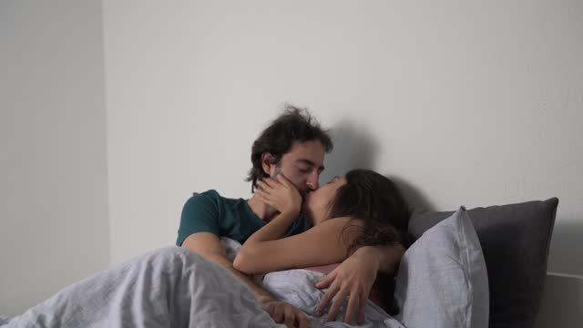 couple kissing on the bed - husband stock videos & royalty-free footage