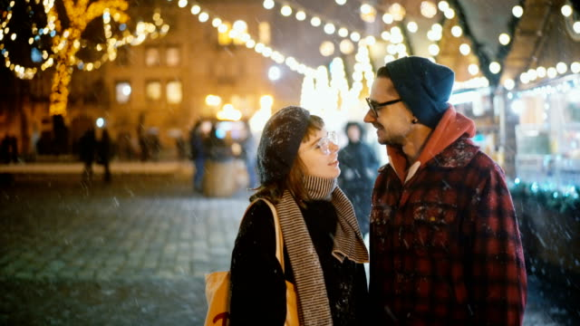 couple  kissing on the christmas market - market stock videos & royalty-free footage