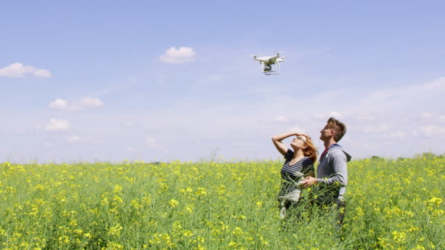 WS Couple kissing while operating a drone