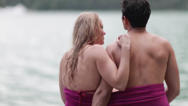 couple kissing with towel around each other - standing water stock videos & royalty-free footage