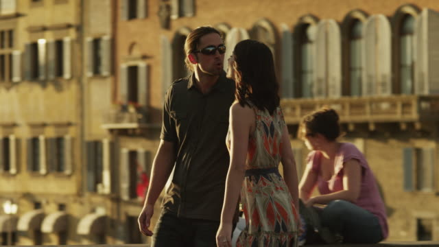 MS PAN Couple kissing,walking through old town street / Florence,Tuscany