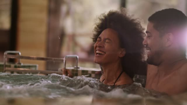 couple laughing in a hot tub at daily spa - heat stock videos & royalty-free footage