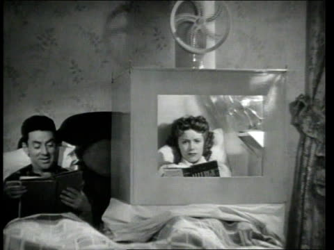 1945 montage a couple laying in bed - married stock videos & royalty-free footage