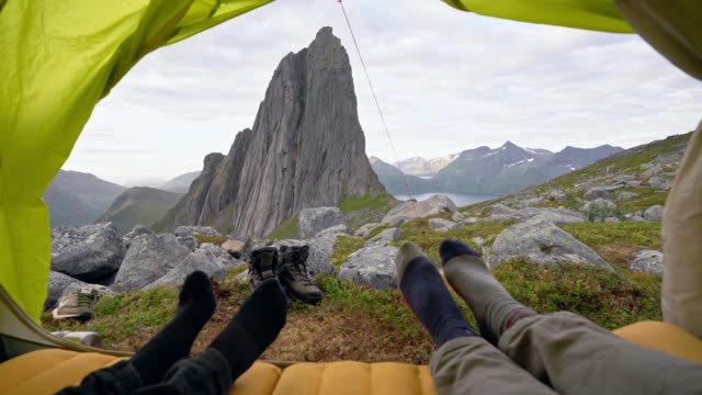 couple laying in tent on senja island in  mountains - tent stock videos & royalty-free footage