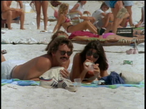 couple laying on the beach in st petersburg, florida - 1985 stock videos & royalty-free footage