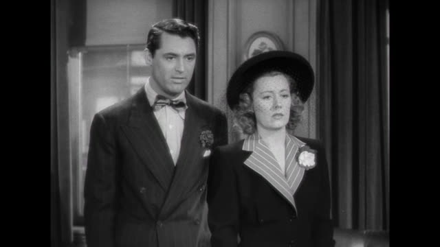 1941 couple (cary grant an irene dunne) learn about adoption agency's rigorous selection process - bureaucracy stock videos & royalty-free footage