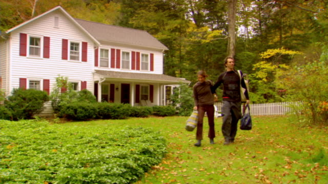 WS, Couple leaving country house, Phoenicia, New York, USA