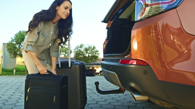 couple loading luggage in car trunk and mounting bicycle on car roof - carrying stock videos & royalty-free footage