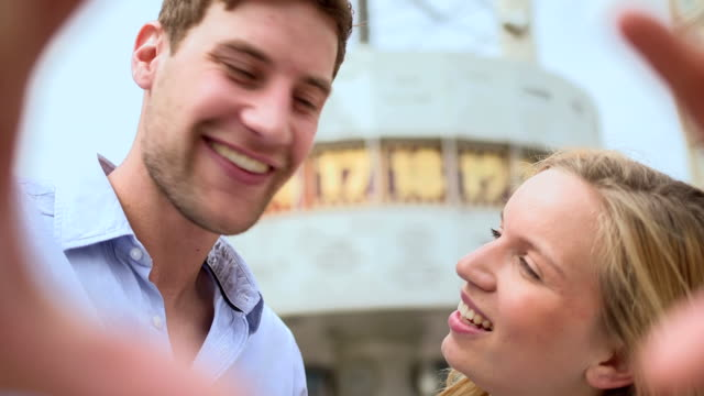 Couple looking at camera and smiling