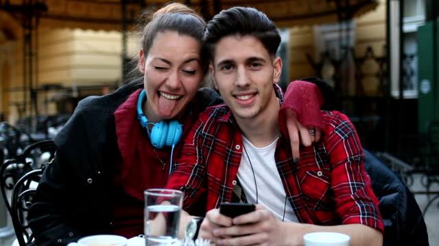 couple looking at camera - fantasia video stock e b–roll