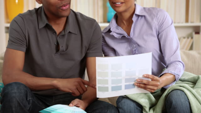 Couple looking at color scheme for decorating