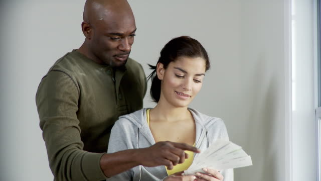 CU, Couple looking at color swatches, Plainfield, New Jersey, USA