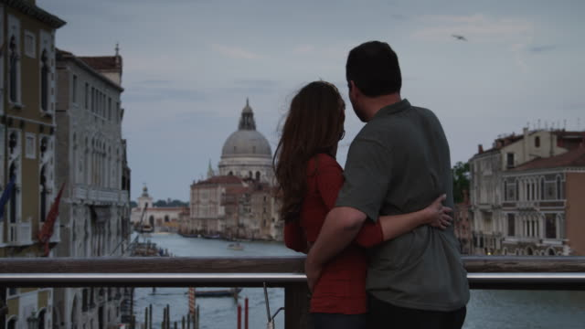 ms couple looking at grand canal from top of bridge / venice,veneto - romance stock videos & royalty-free footage
