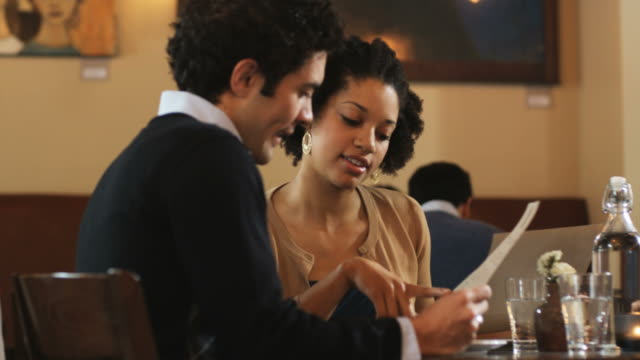 couple looking at menus in a restaurant - menu stock videos & royalty-free footage