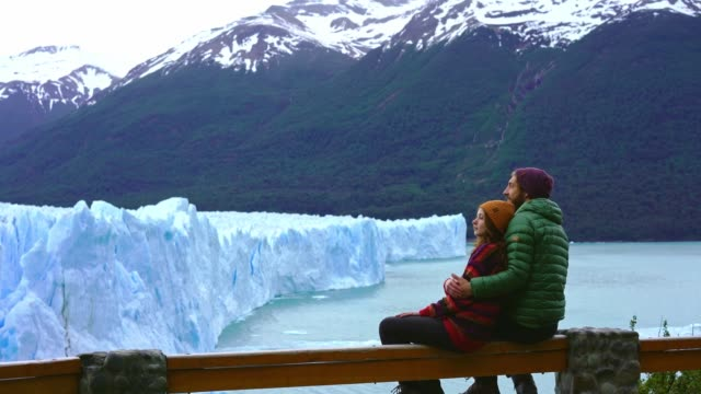 couple looking at scenic view of perito moreno glacier in patagonia - lakeshore stock videos & royalty-free footage