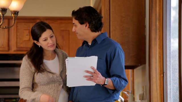 vídeos y material grabado en eventos de stock de ms couple looking at the bills in kitchen / albany,  new york, united states  - factura