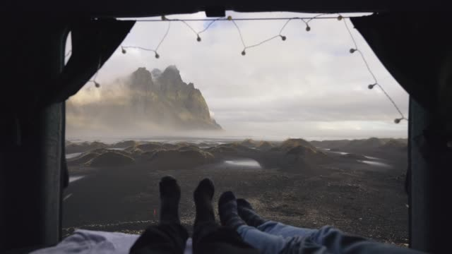 couple looking at vestrahorn mountains from camper van - remote location stock videos & royalty-free footage