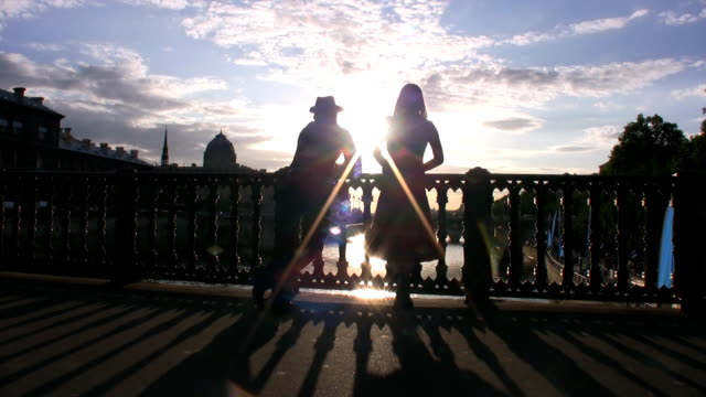 Couple looking sunset