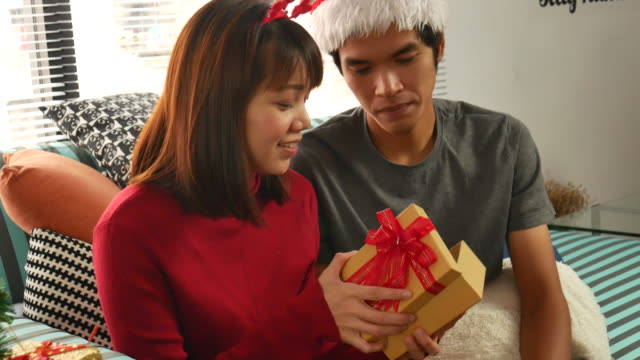 couple love open the christmas gift