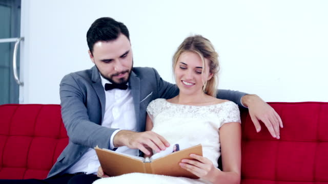 Couple Lover Helping choosing and looking at catalog album