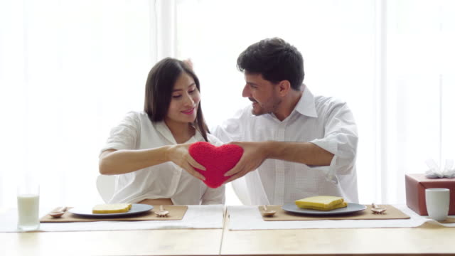 couple lovers holding red heart shape - conceptual symbol stock videos and b-roll footage