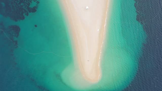 couple lying down on the paradise beach - zlatni rat, bol, croatia - bol stock videos & royalty-free footage