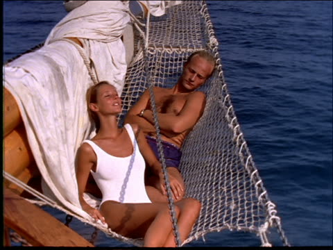 couple lying in boat on ocean - napping stock videos & royalty-free footage