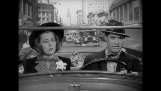 vídeos de stock, filmes e b-roll de 1941 a couple make a trip to an adoption agency (irene dunne & cary grant) - escolhendo