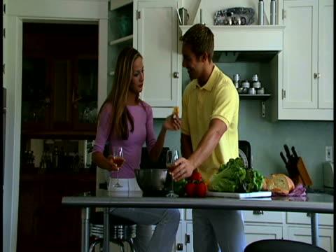 couple making salad - three quarter length stock videos & royalty-free footage