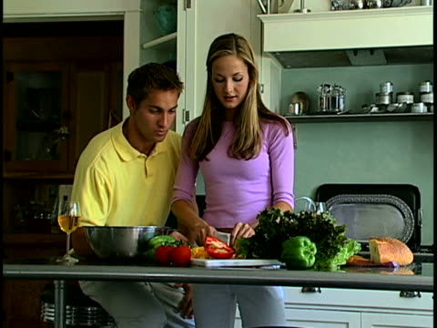 couple making salad - three quarter length stock videos & royalty-free footage