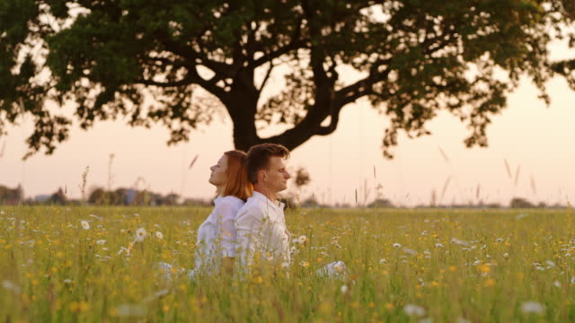 ds couple meditating in nature - mid adult couple stock videos & royalty-free footage