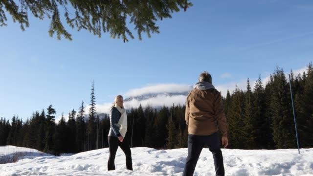 couple meet and walk along snowy trail - eyewear stock videos & royalty-free footage