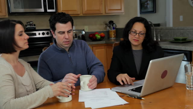 ms couple meeting with advisor at home / albany, new york   united states   - sedia video stock e b–roll