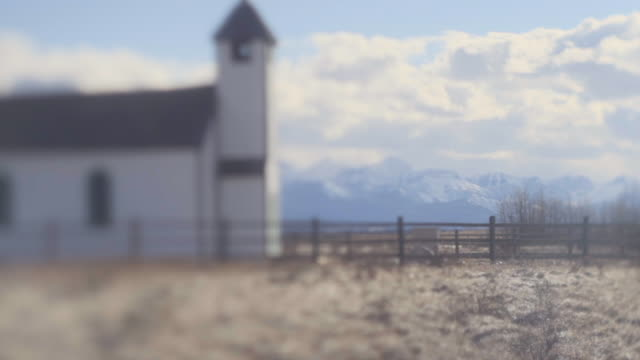 couple mourns outside of church, rural setting - alberta stock videos & royalty-free footage