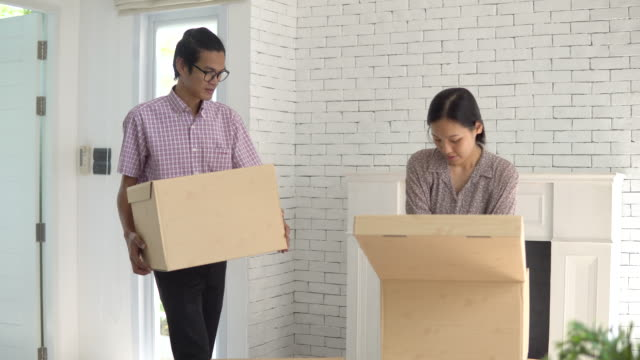 Couple moving in to new apartment