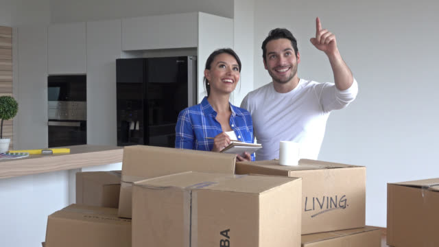 Couple moving in to their flat and planning their new decor