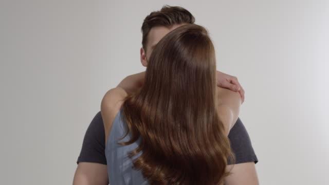 couple moving on white background - zungenkuss stock-videos und b-roll-filmmaterial