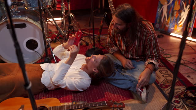 couple musicians relaxing on stage - rock musician stock videos & royalty-free footage