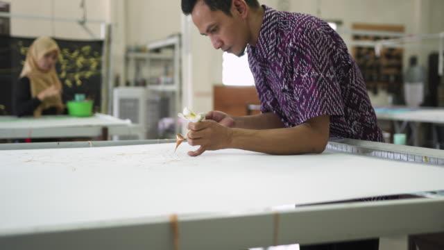 couple of asian people making batik - batik stock videos and b-roll footage