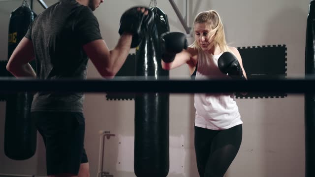 couple of boxers training in the ring together - kickboxing stock videos & royalty-free footage