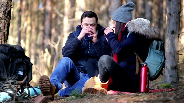 Couple Of Friends Enjoying Their Lunch In Forest