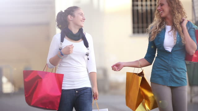 Couple of Girls in Happy Shopping Activity