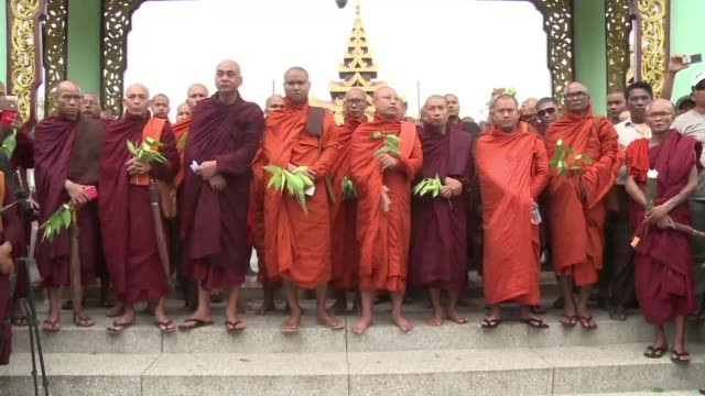 couple of hundred hardliners show their support for firebrand monk wirathu in yangon after a court issued an arrest warrant for the ultra nationalist... - infamous stock videos & royalty-free footage