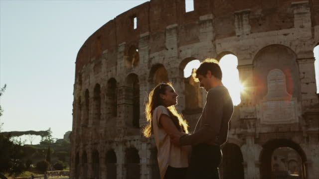 couple of lover tourists in rome by the coliseum - rome italy stock videos and b-roll footage