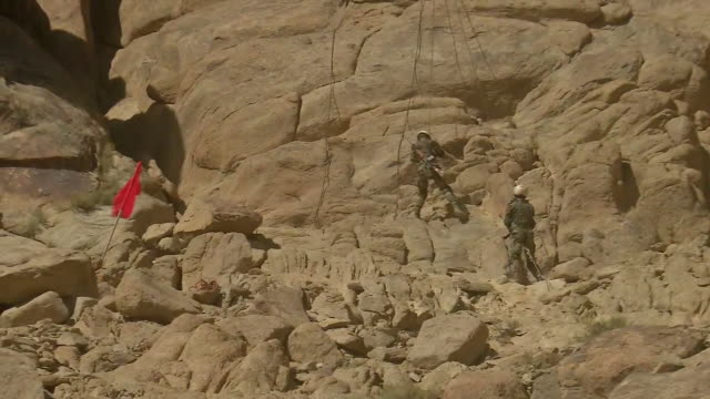 a couple of soldiers from the indian army training themselves at the hills in leh ladakh one of the soldiers can be seen climbing down the hill while... - indian army stock videos & royalty-free footage