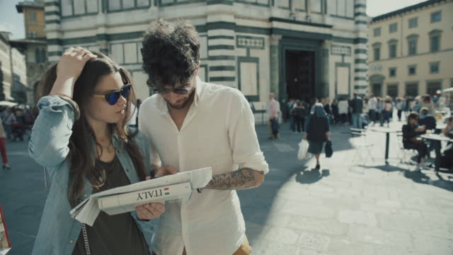 couple of tourists in florence, italy with map - asking stock videos & royalty-free footage